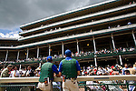 Members of the start crew stop for a moment at the grandstands at Churchill Downs to take in the enormity of the Kentucky Derby. Start crews work seasonally and are busy during Triple Crown season which includes the Kentucky Derby.