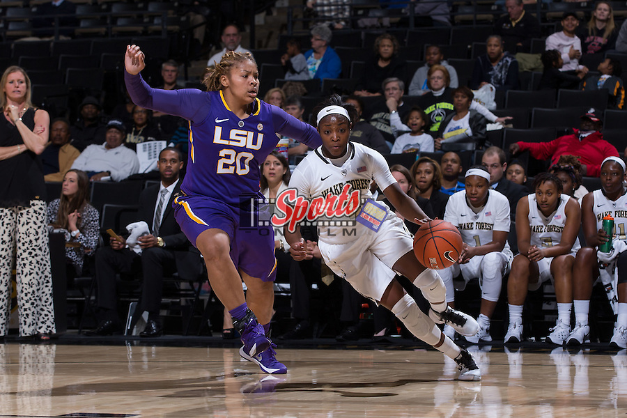 Amber Campbell (2) of the Wake Forest Demon Deacons drives past Alexis Hyder (20) of the LSU Tigers during second half action at the LJVM Coliseum on November 13, 2015 in Winston-Salem, North Carolina.  The Demon Deacons defeated the Tigers 60-57.  (Brian Westerholt/Sports On Film)