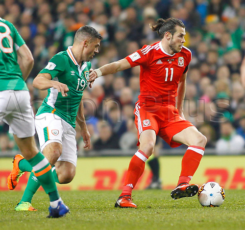 March 24th 2017, Aviva Stadium, Dublin, Republic of Ireland; World Cup 2018 Qualifier mens football, Republic of Ireland versus Wales; Gareth Bale holds off a challenge from Jon Walters