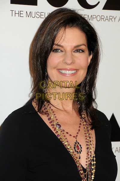 Sela Ward.2011 MOCA Gala - An Artist's Life Manifesto held at MOCA Grand Avenue,  Los Angeles, California, USA, .12th November 2011..portrait headshot black necklaces beads  pink .CAP/ADM/BP.©Byron Purvis/AdMedia/Capital Pictures.