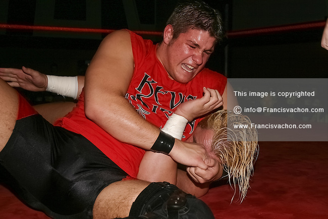 Canadian WWE superstar Kevin Owens, then using his real name of Kevin Steen, is seen in his early wrestling days during a fight with Steve Corino in Quebec City Saturday November 6, 2004.