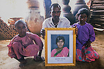 The family of a  suicide in Warangal, India.   Many indian farmers prefer to kill themselves rather than to  face up to the shame of debt - incurred  by  borrowing money to  buy  GM seeds which subsequently  failed to  grow.