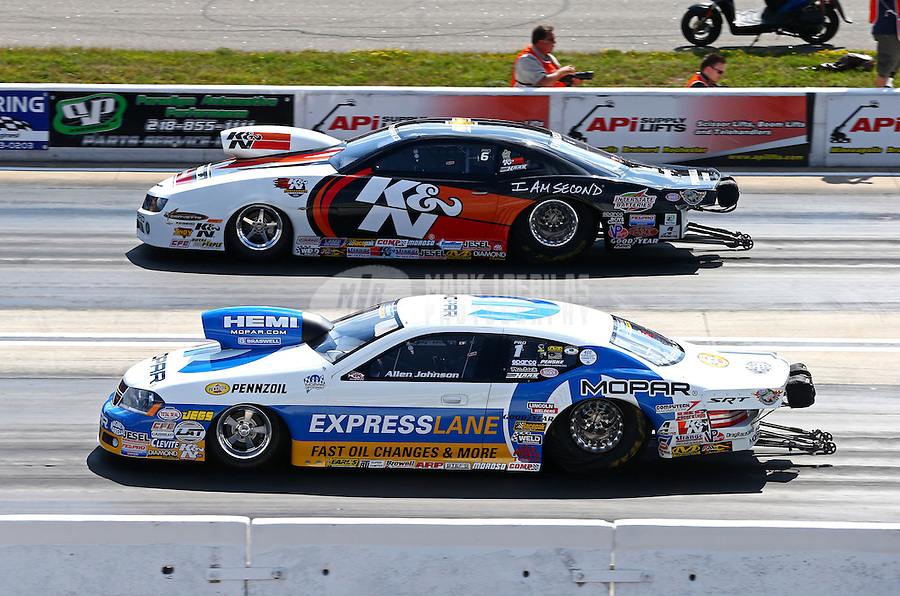 Aug. 16, 2013; Brainerd, MN, USA: NHRA pro stock driver Allen Johnson (near) races alongside Mike Edwards during qualifying for the Lucas Oil Nationals at Brainerd International Raceway. Mandatory Credit: Mark J. Rebilas-