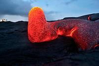 Sunrise, photographer, Pahoehoe lava flow near Royal Gardens subdivision, Kilauea volcano, east of Hawaii, USA Volcanoes National Park, Big Island of Hawaii, USA