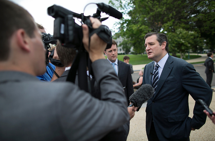 UNITED STATES - JUNE 15 - Sen. Ted Cruz, R-Texas, speaks to reporters after a news conference calling on the House and Senate leadership to not reauthorize the Export-Import Bank on Capitol Hill, Wednesday, July 15, 2015. (Photo By Al Drago/CQ Roll Call)