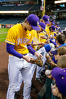 LSU Tigers baseball players sign autographs before the Houston College Classic against the Nebraska Cornhuskers on March 8, 2015 at Minute Maid Park in Houston, Texas. (Andrew Woolley/Four Seam Images)