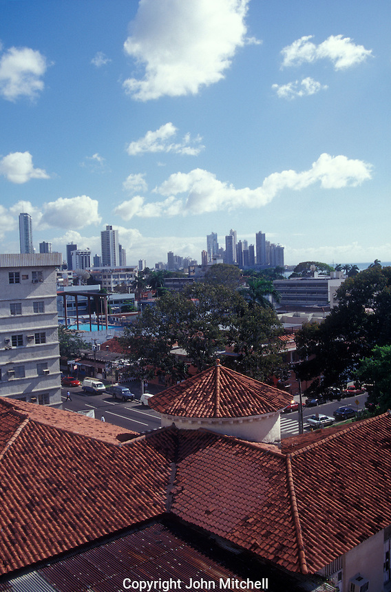 Panama City skyline with red roofs in foreground, Panama City, Panama