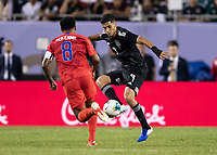 CHICAGO, IL - JULY 7: Raul Jimenez #9 and Weston Mckennie #8 go for the ball during a game between Mexico and USMNT at Soldiers Field on July 7, 2019 in Chicago, Illinois.