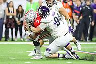 Indianapolis, IN - December 1, 2018: Northwestern Wildcats defensive lineman Ben Oxley (94) tackles Ohio State Buckeyes quarterback Dwayne Haskins (7) during the Big Ten championship game between Northwestern  and Ohio State at Lucas Oil Stadium in Indianapolis, IN.   (Photo by Elliott Brown/Media Images International)
