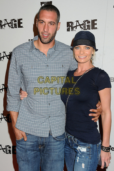 "Guest & Jaime Pressly.""Rage"" Video Game Launch Party held in Chinatown's Historical Central Plaza, Los Angeles, California, .30th September 2011..half length black hat t-shirt jeans ripped  denim  navy blue .CAP/ADM/BP.©Byron Purvis/AdMedia/Capital Pictures."