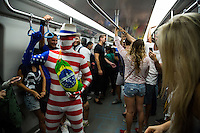 A fan from United States in a disguise goes in the subway of Rio de Janeiro to the mythical Maracana stadium for the match that Argentina won 2-1 on his debut against Bosnia-Herzegovina. Rio de Janeiro, Brazil.