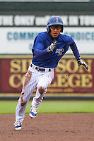 Iowa Cubs infielder Munenori Kawasaki (1) races to third during a Pacific Coast League game against the Colorado Springs Sky Sox on May 1st, 2016 at Principal Park in Des Moines, Iowa.  Colorado Springs defeated Iowa 4-3. (Brad Krause/Four Seam Images)