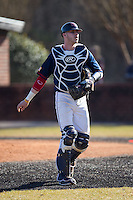 Jake Kennedy (30) of the Shippensburg Raiders walks off the field between innings of the game against the Belmont Abbey Crusaders at Abbey Yard on February 8, 2015 in Belmont, North Carolina.  The Raiders defeated the Crusaders 14-0.  (Brian Westerholt/Four Seam Images)