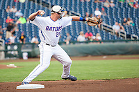 Florida Gators first baseman Peter Alonso (20) warms up before the game against the Miami Hurricanes in the NCAA College World Series on June 13, 2015 at TD Ameritrade Park in Omaha, Nebraska. Florida defeated Miami 15-3. (Andrew Woolley/Four Seam Images)
