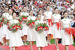 23 August 2008: Chinese ladies carry the medals and flowers onto the field for the ceremony. The Medal Ceremony for the Men's Olympic Football Tournament was held at the National Stadium in Beijing, China after the Gold Medal match.