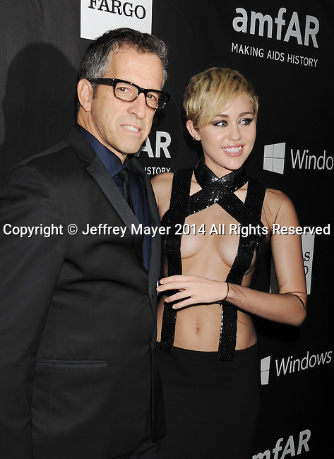 HOLLYWOOD, CA- OCTOBER 29: amfAR Chairman Kenneth Cole (L) and recording artist Miley Cyrus attend amfAR LA Inspiration Gala honoring Tom Ford at Milk Studios on October 29, 2014 in Hollywood, California.