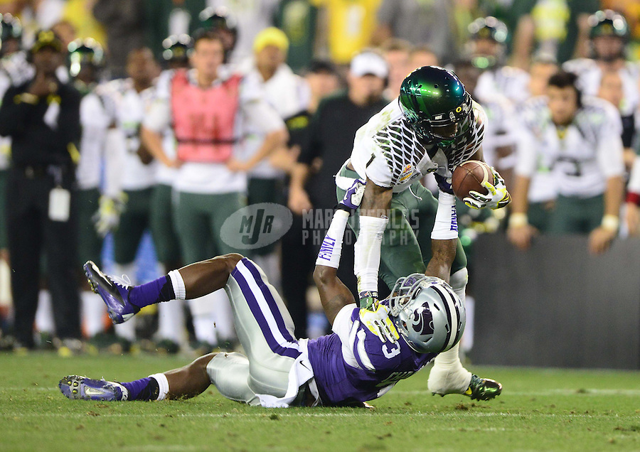 Jan. 3, 2013; Glendale, AZ, USA: Oregon Ducks wide receiver Josh Huff (1) is tackled by Kansas State Wildcats defensive back Allen Chapman (3) during the 2013 Fiesta Bowl at University of Phoenix Stadium. Oregon defeated Kansas State 35-17. Mandatory Credit: Mark J. Rebilas-