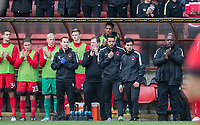 The Orient bench join applause for Lifelong Orient supporter Frankie Bish who recently passed away during the Sky Bet League 2 match between Leyton Orient and Wycombe Wanderers at the Matchroom Stadium, London, England on 1 April 2017. Photo by Andy Rowland.
