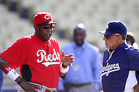 Cincinnati Reds Manager Dusty Baker #12 talks with former Dodger teammate Davey Lopes #15 Los Angeles Dodgers Coach at Dodger Stadium on July 3, 2012 in Los Angeles, California. Los Angeles defeated Cincinnati 3-1. (Larry Goren/Four Seam Images)