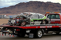 Nov 1, 2014; Las Vegas, NV, USA; The car of NHRA pro stock driver Deric Kramer is towed back to the pits after crashing during qualifying for the Toyota Nationals at The Strip at Las Vegas Motor Speedway. Kramer was unhurt in the accident. Mandatory Credit: Mark J. Rebilas-USA TODAY Sports