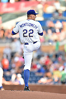 Durham Bulls starting pitcher Mike Montgomery #22 delivers a pitch during a game against the Toledo Mud Hens at Durham Bulls Athletic Park on July 25, 2014 in Durham, North Carolina. The Mud Hens defeated the Bulls 5-3. (Tony Farlow/Four Seam Images)