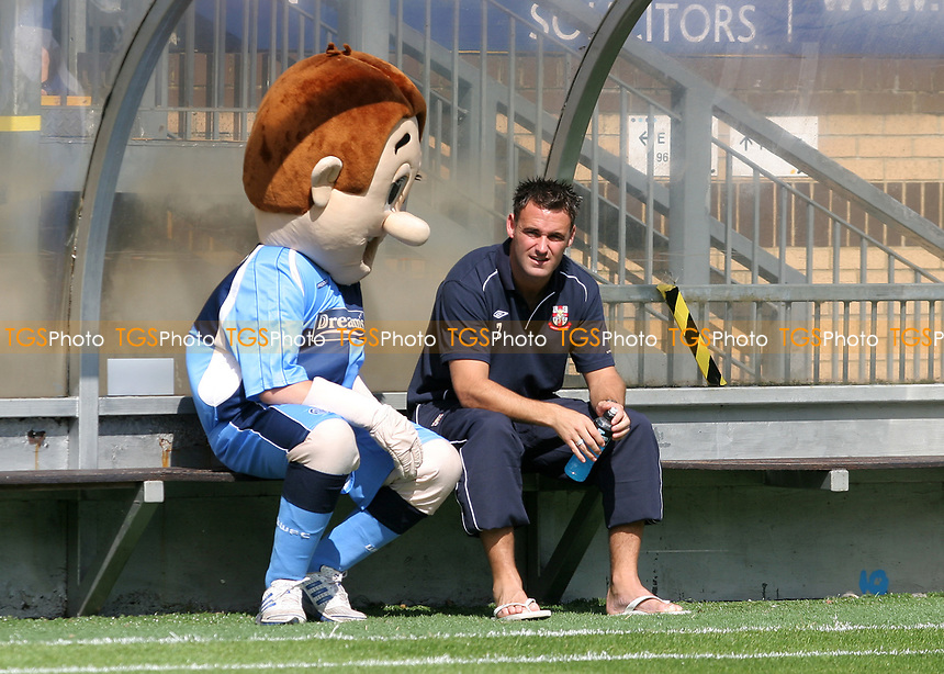 Wycombe Wanderers mascot, Bodger, sits alongside Lincoln player, Stefan Oakes, in the away dug-out during Wycombe Wanderers vs Lincoln City, Coca Cola League Division Two Football at Adams Park on 23rd August 2008