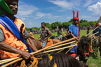 March 29, 2016 - Wainyapu (Indonesia). Riders wait to start a new wave of attacks. A skilled rider can duck an incoming spear and the very best of them can catch the spear in mid-air. For the less agile, the spears, though blunted, can spill blood, which the Sumbanese believe will fertilize the land and produce a better harvest. © Thomas Cristofoletti / Ruom