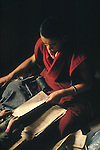 Shigatse, Tibet, a monk doing manual printing at Tashilhunpo Monastery