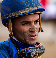 BALTIMORE, MD - MAY 20: Jockey Joel Rosario is left with a muddy face after riding in an undercard race on Preakness Stakes Day at Pimlico Race Course on May 20, 2017 in Baltimore, Maryland.(Photo by Douglas DeFelice/Eclipse Sportswire/Getty Images)
