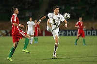 Italy's Andrea Mazzarani (8) takes control of the ball against Hungary during the FIFA Under 20 World Cup Quarter-final match at the Mubarak Stadium  in Suez, Egypt, on October 09, 2009. Hungary won 2-3 in overtime.