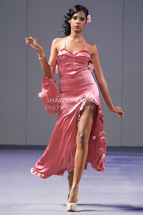 Model walks runway in an outfit from the Tiffany McCall Couture Spring Summer 2013 Femme Bijoux collection, during Couture Fashion Week New York Spring 2013, on September 17, 2012.