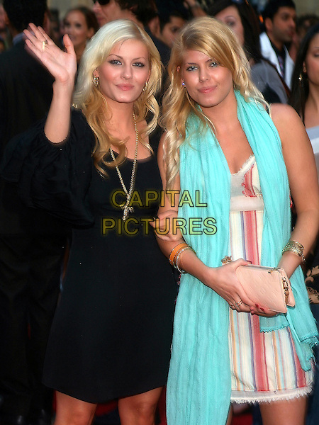 ELISHA CUTHBERT & LEE ANN CUTHBERT.at the 17th Annual MuchMusic Video Awards, CHUM City Building, Toronto, Ontario, Canada,.18 June 2006..half length black dress family sisters hand waving.Ref: ADM/BP.www.capitalpictures.com.sales@capitalpictures.com.©Byron Purvis/AdMedia/Capital Pictures.