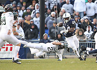 State College, PA - 11/26/2016:  Penn State's Miles Sanders returns a kick beyond the diving tackle attempt by Gerald Holmes (24) of Michigan State. #7 Penn State defeated Michigan State by a score of 45-12 to secure the Big Ten conference East Division championship on Senior Day, Saturday, November 26, 2016, at Beaver Stadium in State College, PA.<br /> <br /> Photos by Joe Rokita / JoeRokita.com