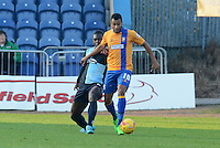 Wycombe Wanderers Aaron Pierre challenges Mansfield Town's Matt Green during the Sky Bet League 2 match between Mansfield Town and Wycombe Wanderers at the One Call Stadium, Mansfield, England on 31 October 2015. Photo by Garry Griffiths.