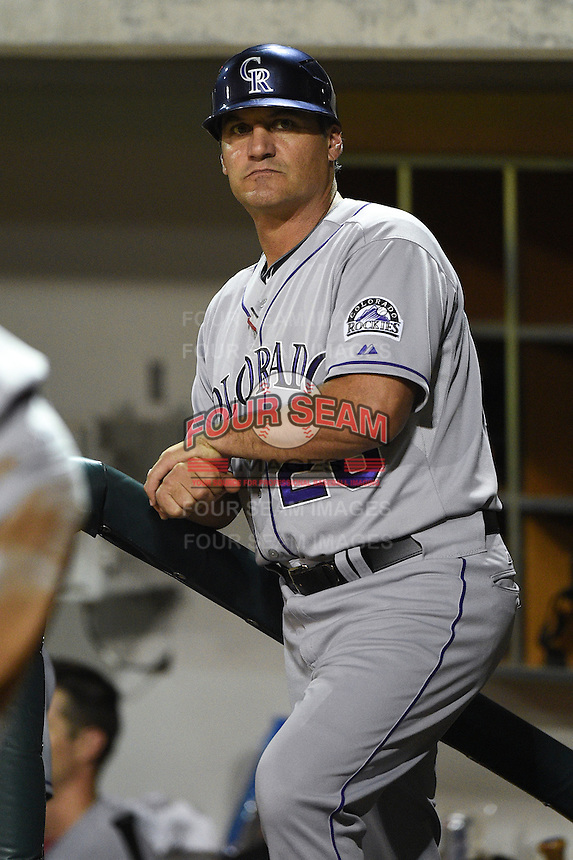 Salt River Rafters coach Kevin Riggs (26) during an Arizona Fall League game against the Mesa Solar Sox on October 18, 2014 at Cubs Park in Mesa, Arizona.  Mesa defeated Salt River 8-4.  (Mike Janes/Four Seam Images)