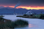 Storm clouds at sunset over Antioch Bridge, from Sherman Island, Sacramento San Joaquin River Delta, California