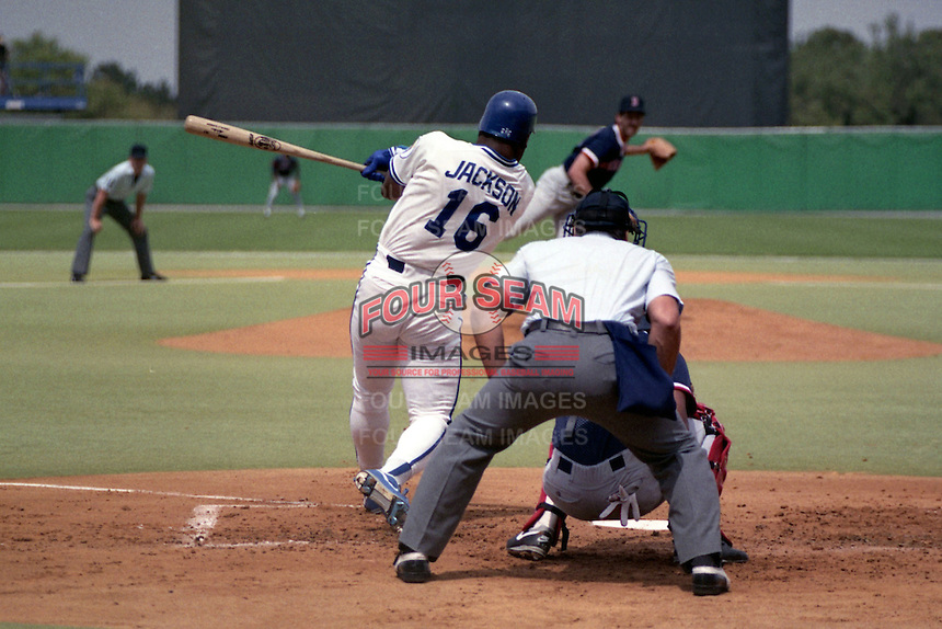 Kansas City Royals Bo Jackson at bat against the Boston Red Sox during spring training circa 1990 at Baseball City Stadium in Davenport, Florida.  (MJA/Four Seam Images)