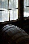 Light from a snow-covered Kentucky shines on a barrel of Knob Creek inside a Jim Beam warehouse.  Knob Creek is a part of the Jim Beam family of bourbons produced in Claremont, Ky.