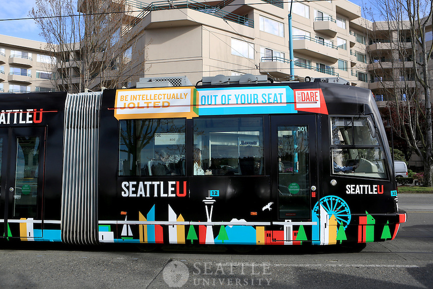 04072015-  Seattle U streetcar wrap on the South Lake Union route in Seattle.