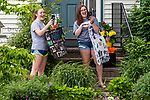 WATERTOWN, CT. 04 June 2020-060420BS236 - Watertown Girls Tennis team quad captains and seniors Abbey, left, and Morgan Holly, both react after being surprised by coaches, players, and parents driving by during a Girls Tennis Team car parade on Thursday. Bill Shettle Republican-American