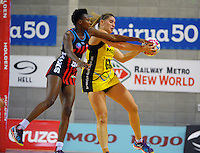Te Huinga Reo Selby-Rickit intercepts a pass to Mwai Kumwenda (left) during the ANZ Netball Championship match between the Central Pulse and Mainland Tactix at Te Rauparaha Arena, Wellington, New Zealand on Saturday, 11 May 2015. Photo: Dave Lintott / lintottphoto.co.nz