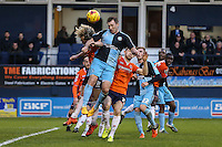 Paul Hayes of Wycombe Wanderers gets in front of Cameron McGeehan of Luton Town (8) during the Sky Bet League 2 match between Luton Town and Wycombe Wanderers at Kenilworth Road, Luton, England on 26 December 2015. Photo by David Horn.