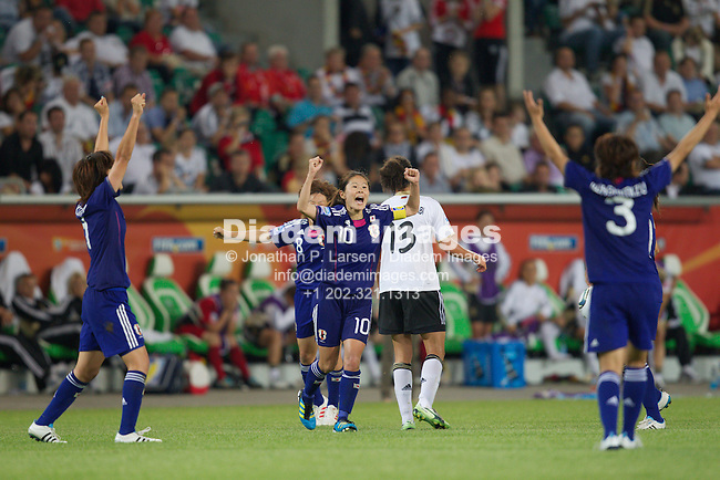 WOLFSBURG, GERMANY - JULY 9:  Japan team captain Homare Sawa (10) and teammates celebrate at the final whistle after defeating Germany in a FIFA Women's World Cup quarterfinal match at Arena Im Allerpark on July 9, 2011 in Wolfsburg, Germany.  Editorial use only.  Commercial use prohibited.  No push to mobile device usage.  (Photograph by Jonathan P. Larsen)