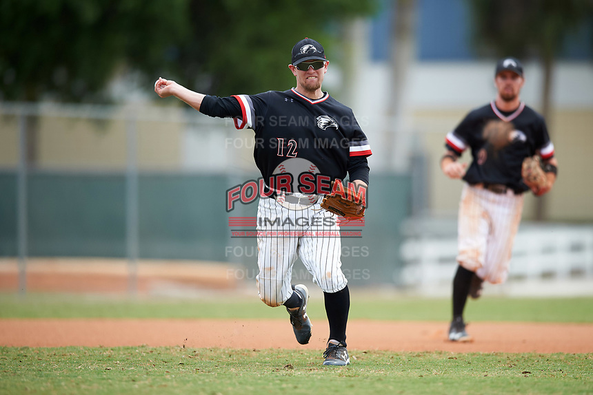 Edgewood College Eagles third baseman Tim Nunn (12) throws to first base during the second game of a doubleheader against Western Connecticut Colonials on March 13, 2017 at the Lee County Player Development Complex in Fort Myers, Florida.  Edgewood defeated Western Connecticut 2-1.  (Mike Janes/Four Seam Images)