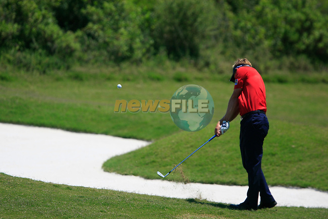 Luke Donald (ENG) chips on the 5th hole during the afternoon Final session on the Final Day of the Volvo World Match Play Championship in Finca Cortesin, Casares, Spain, 22nd May 2011. (Photo Eoin Clarke/Golffile 2011)