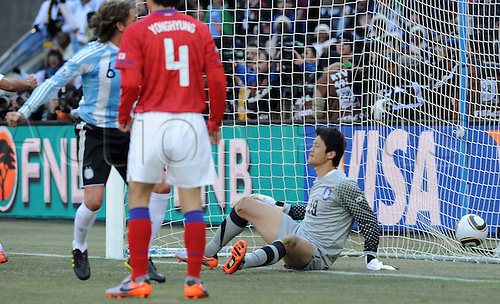Argentina's Gabriel Heinze (6) in action against South Korea's goalkeeper Jung Sung Ryong during the 2010 FIFA World Cup group B match between Argentina and South Korea at Soccer City Stadium in Johannesburg, South Africa 17 June 2010.