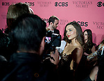 Victoria's Secret Angel Miranda Kerr speaks to the press before Tuesday's screening party for the 2011 Victoria's Secret Fashion Show.
