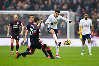 Tottenham Hotspur's Dele Alli under pressure from Huddersfield Town's Christopher Schindler <br /> <br /> Photographer Craig Mercer/CameraSport<br /> <br /> The Premier League - Tottenham Hotspur v Huddersfield Town - Saturday 3rd March 2018 - Wembley Stadium - London<br /> <br /> World Copyright &copy; 2018 CameraSport. All rights reserved. 43 Linden Ave. Countesthorpe. Leicester. England. LE8 5PG - Tel: +44 (0) 116 277 4147 - admin@camerasport.com - www.camerasport.com