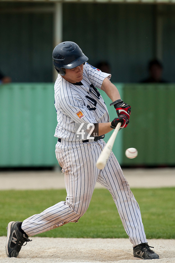 21 May 2009: Boris Marche of Rouen makes contact during the 2009 challenge de France, a tournament with the best French baseball teams - all eight elite league clubs - to determine a spot in the European Cup next year, at Montpellier, France.