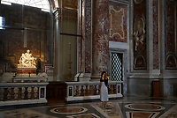 A girl stands by Michelangelo's Pieta while visiting St. Peter's Basilica as it reopens on May 18, 2020 at the Vatican. Italy is slowly lifting sanitary restrictions after a two-month coronavirus lockdown.<br /> UPDATE IMAGES PRESS/Isabella Bonotto<br /> <br /> STRICTLY ONLY FOR EDITORIAL USE